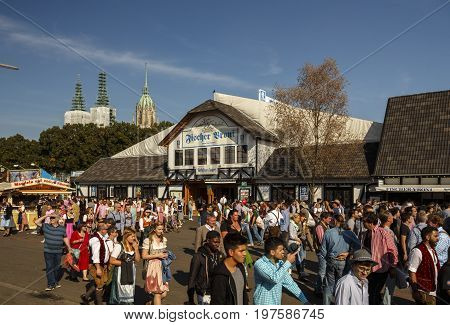 Munich Germany - September 24 2016: Fischer Vroni tent on the Theresienwiese during Oktoberfest with unidentified people walking by