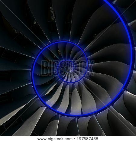 Turbine blades wings spiral blue neon glow effect abstract fractal pattern background. Spiral industrial production metallic turbine background. Turbine technology abstract fractal pattern