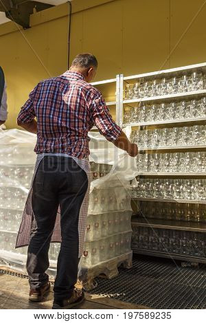Munich, Germany - September 24, 2016: Behind the scenes of the Oktoberfest in the beer garden of the Ochsenbraterei with beer steins being prepared