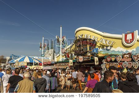 Munich, Germany - September 24, 2016: Facade and entrance of the Ochsenbraterei beer tent with unidentified people on the main stree passing by