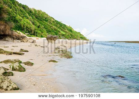 Beach with clifs and ocean in Bali