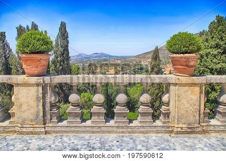 Garden terrace with balustrade and beautiful landscape, Italy
