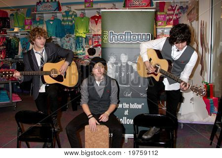 LOS ANGELES - DEC 18:  New Hollow - Evan West, Chad Blashford, and Mick Clouse at an appearance by the band