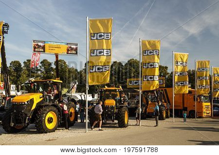 Munich, Germany - September 24, 2016: Agricultural machinery on the Theresienwiese during the Bavarian Agricultural Fair with unidentified people walking by the fair was in parallel during Oktoberfest