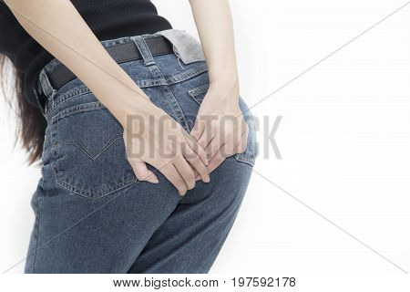 Woman has diarrhea holding her bum, pain in the butt, isolated on white background