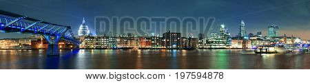 Millennium Bridge and St Pauls Cathedral at night in London
