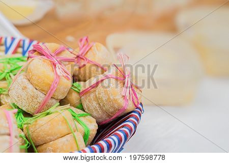 Close-up of plate with the colors of the national flag with small heads of french cheese, tied together, few pieces. Delicious gourmet gift. With place for your text, selective focus