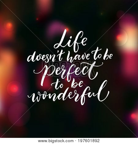 Life doesn't have to be perfect to be wonderful. Inspirational quote, brush lettering on dark background with pink bokeh