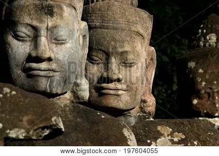 Angkor Thom,  located in present-day Cambodia, was the last and most enduring capital city of the Khmer empire. It's one of the most beautiful ruins in the area. Famous for it's famous faces.
