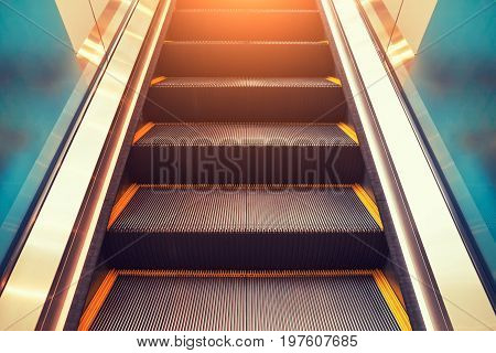 Escalator and step inside building and lighting.