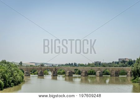 The Roman Bridge Of Cordoba On The Guadalquivir River