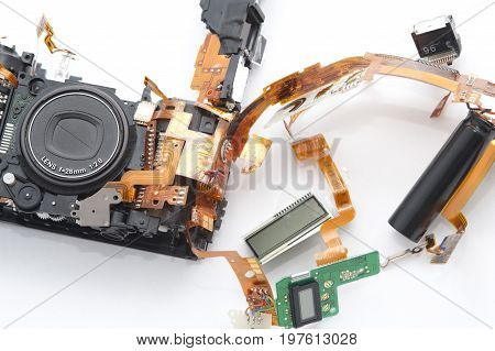 Electronic parts of disassembled compact camera in close-up