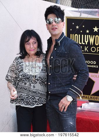 LOS ANGELES - JUL 20:  Criss Angel, mother Dimitra Sarantakosa arrives for the Criss Angel Hollywood Walk of Fame Star Ceremony on July 20, 2017 in Hollywood, CA
