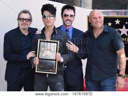 LOS ANGELES - JUL 20:  Gary Oldman, Criss Angel, Lance Burton and Randy Couture arrives for the Criss Angel Hollywood Walk of Fame Star Ceremony on July 20, 2017 in Hollywood, CA