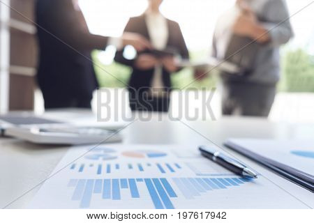 Teamwork process Blurred abstract background of Business people meeting discussing and analysis working with new startup project Financial investment market growth.