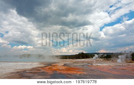 Black Sand Geyser Basin in cumulus clouds in Yellowstone National Park in Wyoming USA