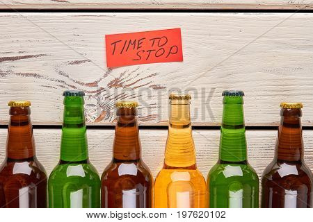 Several glass bottles close up. Time to stop drink alcohol beverage.