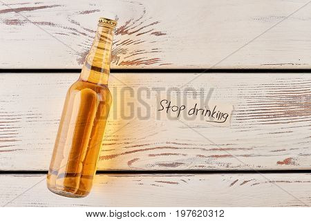 Drinking beer because of loneliness. Alcohol beverage, message, vintage background.