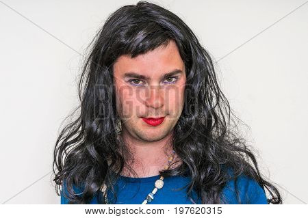 Man Wearing Makeup And Dress Looks Like As A Woman