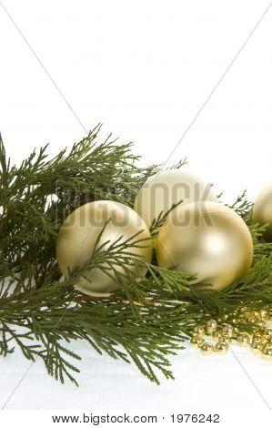 Christmas Baubles And Evergreen