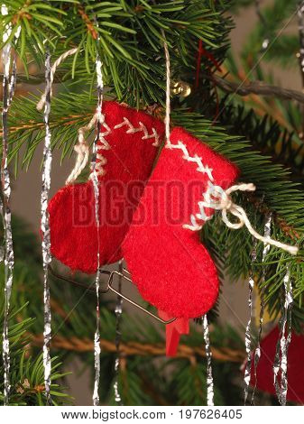 Hand crafted traditional Christmas tree decoration red boots hanging on a tree branch Melbourne 2016