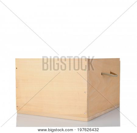 An empty wooden wine crate with rope handle isolated on white with reflection.