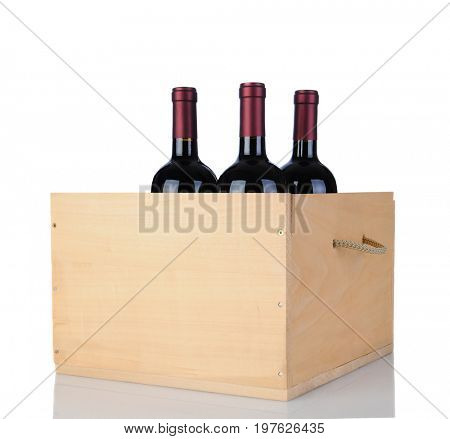 Three Cabernet Sauvignon wine bottles in a wooden crate, isolated on white with reflection.