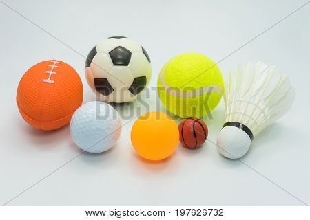 Sports concept : Various sports balls including - small Soccer, small Rugby, Golf, Tennis, Table tennis, Tiny basketball Badminton shuttle cock - all on white background.