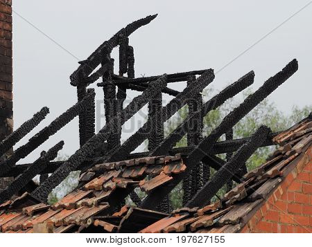Blackened roof rafters of a burned down residential building after a fire Melbourne