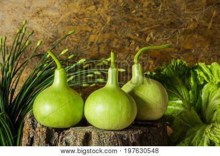 Still life art photography with calabash on the timber