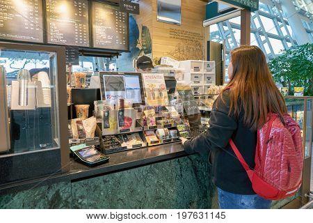 INCHEON, SOUTH KOREA - CIRCA JUNE, 2017: Starbucks at Incheon International Airport. Starbucks Corporation is an American coffee company and coffeehouse chain.