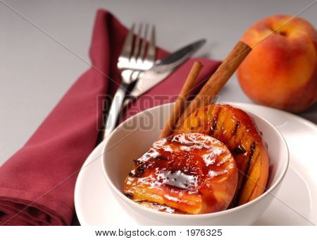 Grilled Peaches With Raspberry Sauce And Cinnamon Sticks