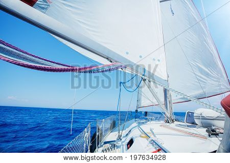 View of the prow of a yacht and the boom