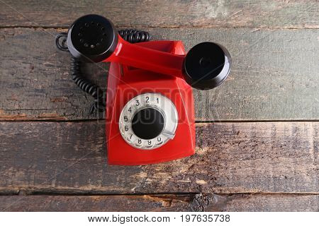 Red Retro Telephone On Grey Wooden Table