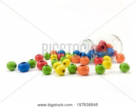 Colorful wooden beads isolated on white background.