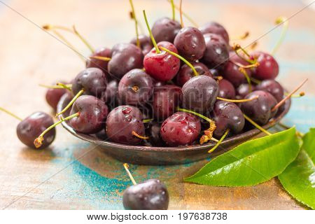 Fresh Ripe Black Cherries In A Bowl On A Wooden Background
