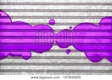 Purple bubbles painted with spray paint on a roller shutter.