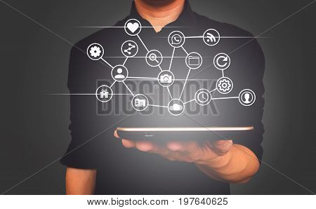 Tablet  smart phone on human hand for business, network, social media concept.
