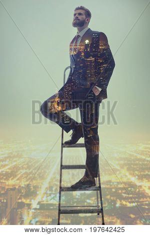 Dreamful man is striving for career advancement. He is standing on steps with cityscape on background. Executive is looking up with hope. Double exposure