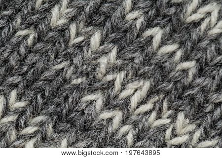 A beautiful closeup of a hand knitted warm and soft wool pattern. Soft socks or scarf of natural wool.
