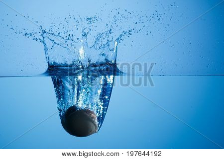 Egg thrown into the water generating splash at high speed