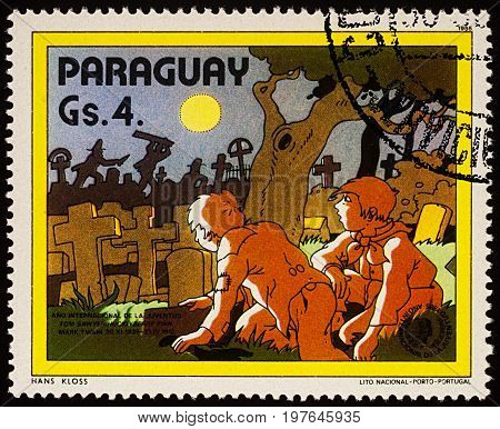 Moscow Russia - July 30 2017: A stamp printed in Paraguay shows Tom Sawyer and Huck Finn at the cemetery Adventures of Tom Sawyer by Mark Twain series