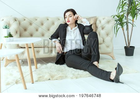 Bold woman sitting on the floor she misses.