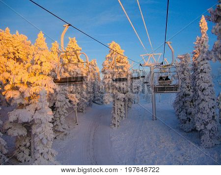 Ski-lifts and forest in a snowy ski resort in Finnish Lapland