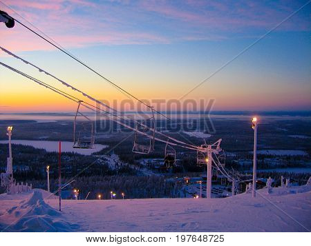 Ski-lifts in a sunset in snowy Finnish Lapland