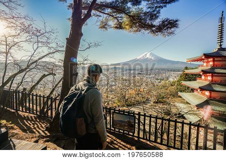 Photographer man at the Chureito Pagoda for looking at Fuji San mountain taken in Japan on 6 December 2016
