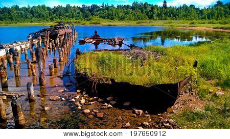 A grass-filled old shipwreck in Russian Karelia