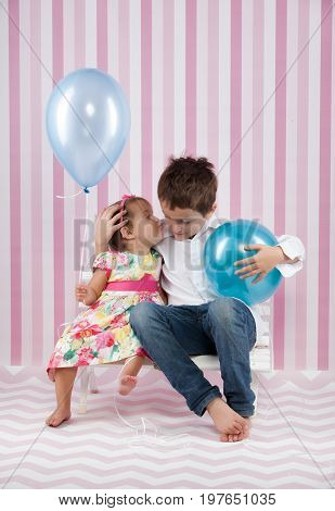 happy kids with a blue ballons in studio