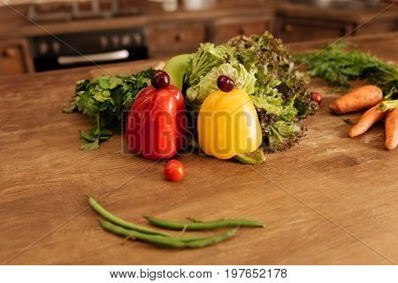 Art of living healthy. Ripe bright lovely set of vegetables lying on the table in the kitchen and waiting becoming tasty vegetarian course