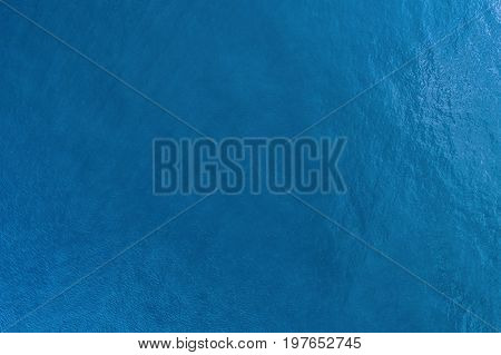Vast blue ocean background with moderate waves view from high above